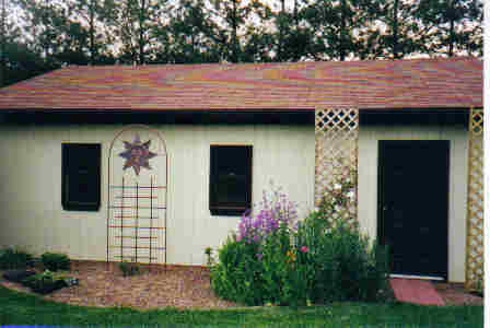 Garage with wildflowers and sun trellis